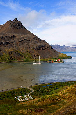 SY Adele, 180 foot Hoek Design, anchored at King Edward Point, near the abandoned whaling station in Grytviken and the whalers cemetery where Shackleton was buried South Georgia, February 2007  -  Rick Tomlinson/ npl