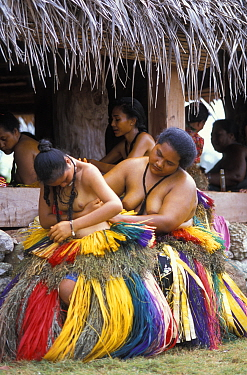 Yapeese girls dressing for the dancing at a local feast, Yap, Micronesia  -  Roberto Rinaldi/ npl