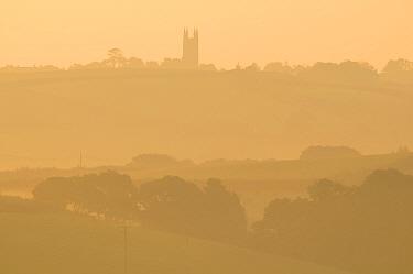 Week St Mary church and surrounding countryside in early morning mist, north Cornwall, UK September 2008  -  Ross Hoddinott/ npl