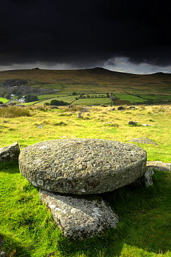 Hut circle remains and large circular granite slab, against stormy sky, Merrivale, Dartmoor NP, Devon, UK September 2008  -  Ross Hoddinott/ npl