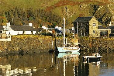 Boats moored alongside on a still morning at a village in the Western Isles, Scotland 1992  -  Gary John Norman/ npl