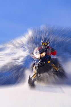 Snowmobiling in the Bridger, Teton National Forest on Togwotee Pass near Dubois, Wyoming Model released, January 2009  -  Jeff Vanuga/ npl