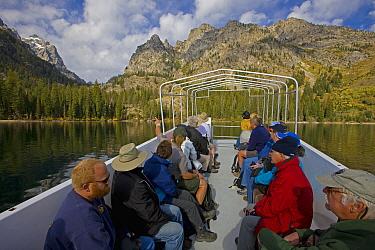 Tourists on Boat shuttle across Jenny Lake to Cascade Canyon Trailhead and Hidden Falls, Grand Teton National Park, Wyoming, USA, June 2008  -  Jeff Vanuga/ npl
