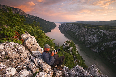 Photographer, Ruben Smit, above the River Danube flowing through the Iron Gate Gorge, on the border between Romania and Serbia, Djerdap National Park, Serbia, June 2009  -  WWE/ Smit/ npl