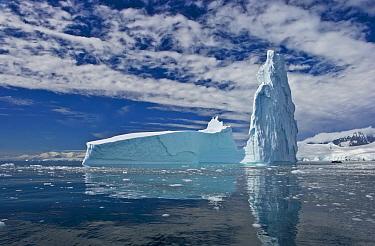 Iceberg reflected in sea, Fournier Bay, Antarctica (non-ex)  -  Andy Rouse/ npl