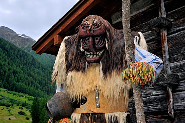Wooden model wearing Tsch?gg?tta mask and tunic made of sheep or goat skins, and ringing bells, a tradition in the L�tschental, Switzerland  -  Philippe Clement/ npl