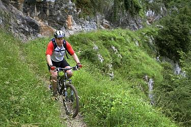 Man mountain biking in Desfiladero gorge, de Les Xanes, Somiedo Natural Reserve, Asturias, Spain July 2008  -  Angelo Gandolfi/ npl