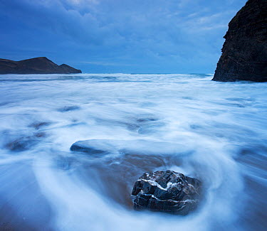 High tide at twilight over quartz-veinded rock on Crackington Haven beach, Cornwall, England March 2009  -  Adam Burton/ npl