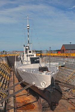 Surviving World War 1 warship Monitor 33, built in 1915 as a floating gunplatform, in dry dock Portsmouth Historic Dockyard, UK July 2010  -  Graham Brazendale/ npl