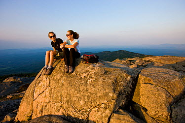Two women hikers sitting on the summit of Mount Monadnock in Monadnock State Park, New Hampshire, USA, September 2008 Model released  -  Jerry Monkman/ npl