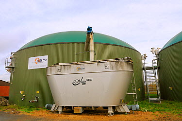 Biogas plant with fermenting chamber for methane production from maize silage, with silage hopper in foreground Cornau, near Vechta, Lower Saxony, Germany  -  Nick Upton/ npl