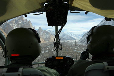 Rear view of pilots and glacier in the Karakoram Mountains, Himalayas, Pakistan, from Pakistani military helicopter, for BBC series Planet Earth April 2005  -  Jeff Wilson/ npl