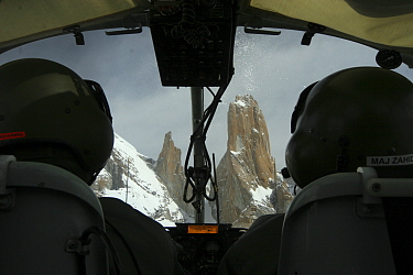 Rear view of pilots and Trango towers in the Karakoram Mountains, Himalayas, Pakistan, from Pakistani military helicopter, for BBC series Planet Earth April 2005  -  Jeff Wilson/ npl
