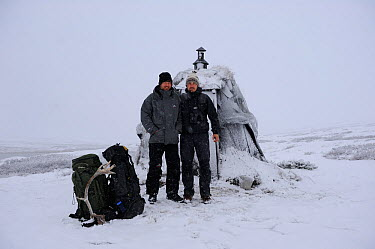 Photographer, Vincent Munier, and Laurent Joffrion standing outside hut, Forollhogna National Park, Norway, September 2008 On location for Wild wonders of Europe  -  WWE/ Munier/ npl