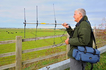 RSPB volunteer Peter Broxholme radiotracking Common, Eurasian cranes (Grus grus) released by the Great Crane Project onto the Somerset Levels and Moors Somerset, UK, October 2010  -  Nick Upton/ npl