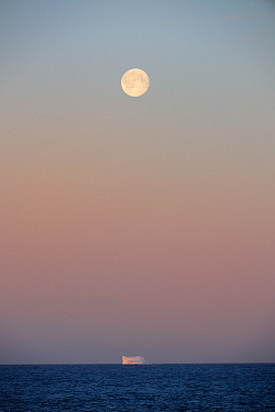 Icerberg at sunset with full moon, in Davis Strait, off south Baffin island, Nunavut, Canada, August 2010  -  Eric Baccega/ npl