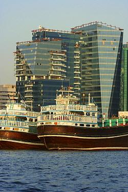 Traditional freight-carrying dhows loading up along Dubai creek, Dubai, United Arab Emirates, February 2010  -  Miles Barton/ npl