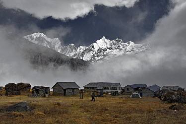 Annapurna base camp (altitude 4130m), with Annapurna III (7555m, left) and Gangapurna (7454 m) seen through a gap in the clouds Nepal, November 2007  -  Michel Petit/ npl