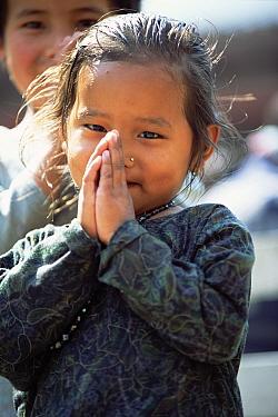 Namaste! traditional Nepali greeting from child in Kagbeni, Nepal  -  Andrew Parkinson/ npl