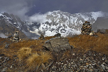 Piles of rocks and Annapurna I (8091 m) seen from Annapurna base camp, Nepal, November 2007  -  Michel Petit/ npl