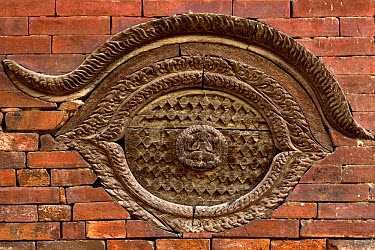 Wooden sculpture of all seeing eye, in a house wall, Pashupatinath, Nepal, November 2007  -  Michel Petit/ npl
