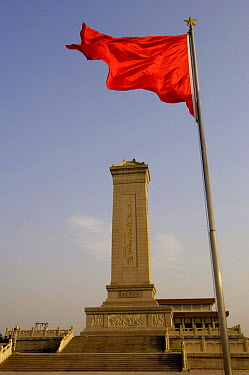 Red flag flying by Monument to the People's Heroes, Tiananmen Square, Beijing, China 2006  -  Pete Oxford/ npl