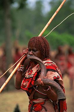 Maasai warrior blows Kudu horn, Eunoto ceremony, Mara Region, Kenya  -  Peter Blackwell/ npl