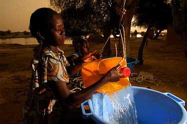 Young Fulani women drawing water from a well shaft built by the United Nations High Commision for Refugees, North Senegal, West Africa, 2005  -  Laurent Geslin/ npl