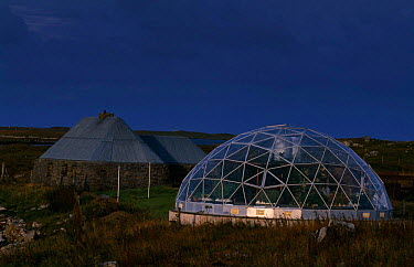 Geodesic greenhouse and restored Black house on the Isle of Uist Scotland, UK  -  Niall Benvie/ npl