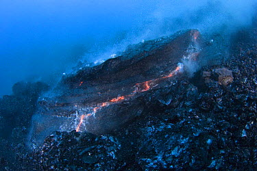 Hot molten pillow lava erupts from an underwater lava tub at ocean entry of eruption from Kilauea Volcano, Hawaii, USA  -  Doug Perrine/ npl