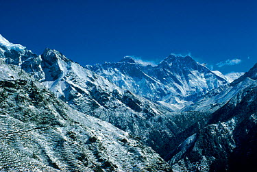 Distant view of Everest showing behind south face of Lhotse, Himalayas, Nepal  -  Leo & Mandy Dickinson/ npl