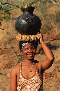 Zulu woman carrying water, Simunye Zulu Lodge, South Africa  -  Dan Burton/ npl