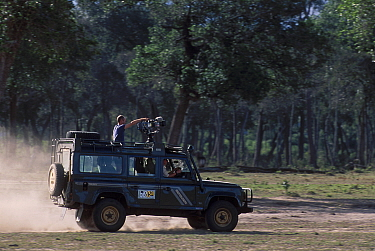 Simon King presenter of Big Cat Diary in vehicle with film camera Masai Mara NR Kenya 200  -  Angela Scott/ npl