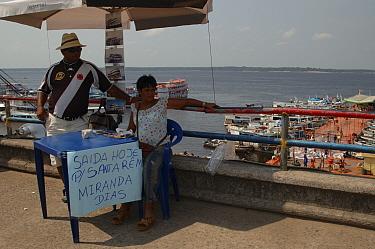 Ticket sellers for boat journeys on the Amazonas river, Brazil  -  Daniel Gomez/ npl