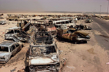 Iraqi vehicles destroyed by allied fire on road to Basra, Iraq, in 1st Gulf War, Kuwait 1990  -  Ross Couper-Johnston/ npl