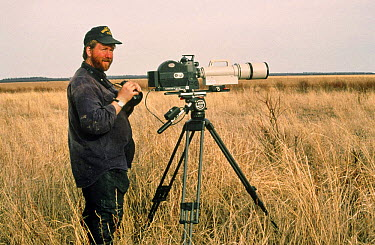 Cameraman Jeff Turner on lookout for wolves, Wood Buffalo NP, Canada, 1996  -  Jeff Turner/ npl