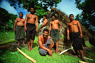 Niuafo'ou villagers outside the fale hut the have built in a day, Tonga  -  Phil Chapman/ npl