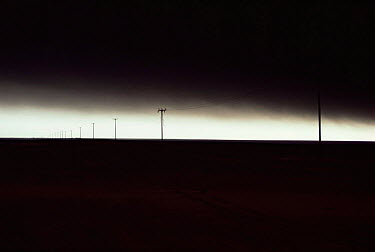 Sky and ground blackened by smoke and fallout from bombed oil wells after 1st Gulf war, Kuwait 1990  -  Ross Couper-Johnston/ npl