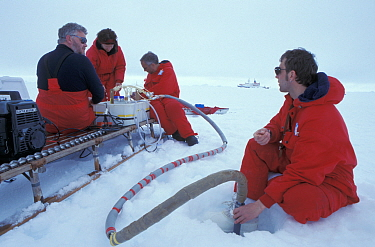 Researchers collecting water samples through the ice, ISPOL (ICE Station Polarstern) Expedition 2004, 2005 from Alfred Wegener Institute, Bremerhaven, Germany The Icebreaker Polarstern was drifting fo...  -  Ingo Arndt/ npl