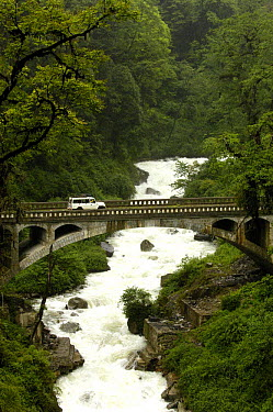 Vehicle crossing bridge over the Nu River Canyon near Gongshan in Dulongjiang Prefecturate, Yunnan Province, China 2006  -  Pete Oxford/ npl