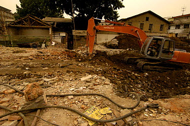 Bulldozers removing old buildings in Dashanlan Street which forms part of the 'Hutongs' or networks of alleys and traditional courtyards, most of which have been destroyed to make way for a modern Bei...  -  Pete Oxford/ npl