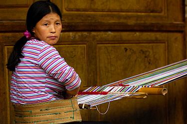 Dulong woman weaving cloth for their traditional dress, Gongshan County, Yunnan Province, China 2006  -  Pete Oxford/ npl
