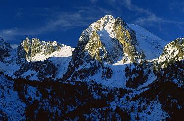 Sunlight on mountain peaks, Aigues Tortes, Estany St Maurici NP, Pyrenees, Catalonia, Spain  -  Juan Manuel Borrero/ npl
