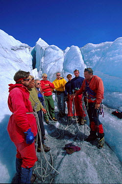 Climbers on Svellnosbreen glacier, Jotunheimen NP, Norway  -  Asgeir Helgestad/ npl