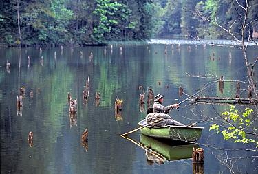 Man in small boat, fishing in river, South Carpathian Mountains, Romania  -  Angelo Gandolfi/ npl