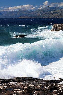 Waves breaking onto rocky shore, northeast coast of Corfu, with the Albanian coast in the background, Corfu, Greece, June 2010  -  Toby Roxburgh/ npl