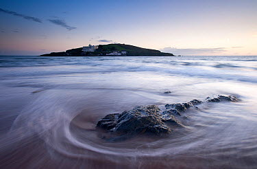 Burgh Island in the late evening light with seaweed washed onto the shore in the foreground Bigbury-on-Sea, South Devon, UK, September 2010  -  Ross Hoddinott/ npl