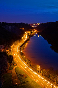 Long exposure view of the Avon Gorge at night, with the lights of cars on the road and the illuminated Clifton Suspension Bridge Bristol, UK, November 2009  -  Steve Nicholls/ npl