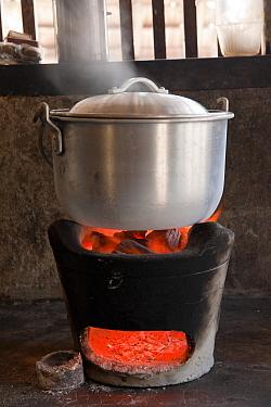 A casserole of rice cooking over charcoal on a terracotta cooker Green Island, Palawan, Philippines, April 2009  -  Jurgen Freund/ npl