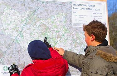 Two boys looking at map of the National Forest, Moira, Derbyshire, UK, November 2010  -  Peter Cairns/ 2020V/ npl